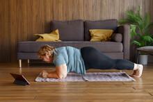 Chubby Mature Female Doing Plank