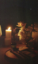 Night Scene Of A Tablescape With Flowers And Candles