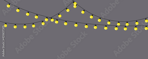 Fotografering golden lamp garland gray background