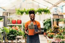 Man Weeding At Greenhouse