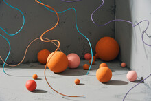 Abstract Composition Of Objects: Balls And Cords On A Gray Background