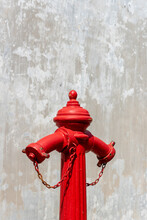 Fire Hydrant Isolated Over A Gray And White Textured Background