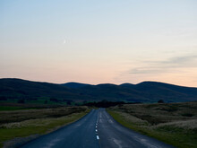 Crescent Moon Over Howgill Fells And Road To Sedburgh At Dusk. Cumbria, UK.