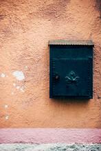 Green Mailbox On Orange Wall