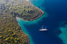 Aerial View Of An Manoeuvring Sailboat