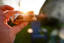 Hand Holding Peanut Butter Cup S'more With Lens Flare