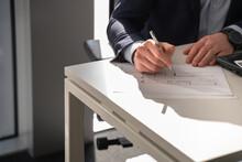 Real Estate Broker Checking Floor Plan