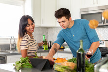 Couple Looks At Tablet To Check Recipe