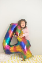 Child With Birthday Balloon