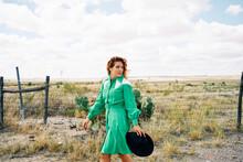 Texas Western Cowgirl Walking Near A Ranch.