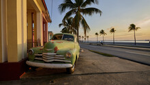 Corroded Retro Car At Sunset