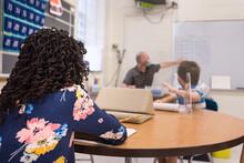 African American Girl Listening To Teacher In Class