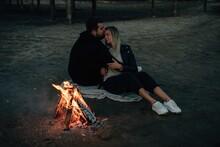 Couple Near Bonfire In Twilight