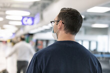Travel: Man With Face Mask Walks Through Airport