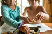 Curly Haired Brother And Sister Eat S'mores