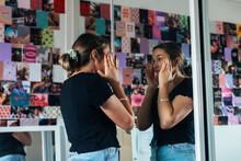 Teen Putting On Make Up