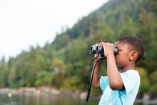 Black Boy Looks Through Binoculars