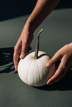 Woman Holding A White Pumpkin