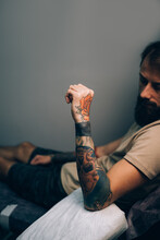 Hand Of A Young Man With Colorful Tattoos