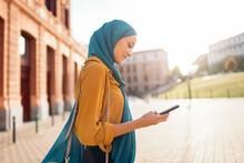Muslim Woman Using Phone