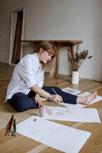 Illustrator Working In Her Studio
