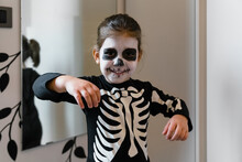 Little Skeleton Near Mirror At Home
