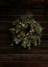 Spruce Wreath On Old Wooden Door