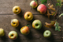 Apples On A Wooden Board