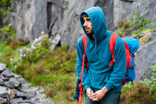 Climber With Backpack And Hoodie In Slate Quarry
