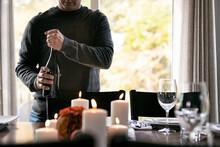 Thanksgiving: Man Opens Wine Bottle For Festive Dinner