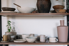 Ceramic Tableware And Vases On Shelves In A Showroom