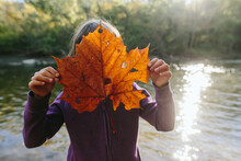 Child Holding Large Leaf