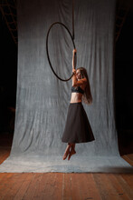 Aerial Artis Suspended On A Lyra Or Aerial Hoop