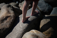 Girl Walks Across Ammonite Fossils On The Jurassic Coast