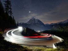Light Trails On Narrow Bend On Mountain Pass Road.