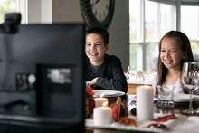 Thanksgiving: Kids Laugh While Having Holiday Video Chat