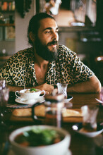 Man In A Leopard Shirt At The Dinner Table