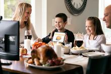 Thanksgiving: Boy Shows Off Illustration On Tablet