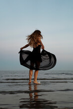 Woman Performer Dancing At The Beach At Sunset