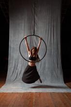 Aerial Artist In A Dynami Pose On A Lyra Or Aerial Hoop