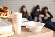 Dishware And Food For Homeless People On Table In Warming Center