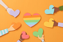 Different Color Hands Holding Colorful Heart