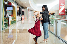Pregnant Woman And Her Daughter In The Mall