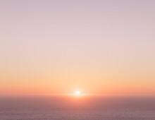Setting Sun Over Vast Ocean
