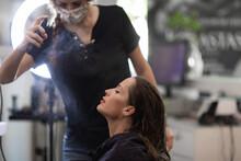 Hairdresser Spraying Her Client's Hair