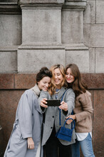 Cheerful Girlfriends Taking Selfie On Street