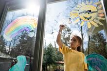 Child Painting Happy Mural On Sliding Door