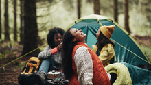 Laughing Friends Camping In The Woods