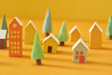 Miniature Houses Village Over Yellow Background,