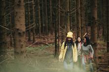 Friends Walking Through A Forest